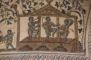 Pisando uvas. Mosaíco en Roma.